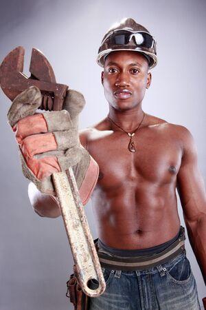 Muscular African American iron worker 版權商用圖片
