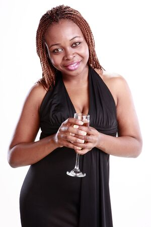 Caribbean young woman and a Champagne flute photo