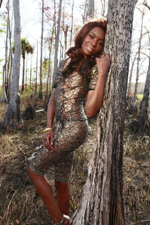 transparent dress: Sexy African American in the woods