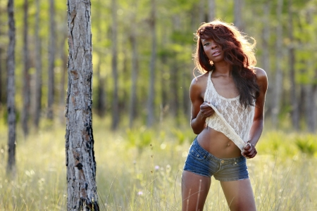 Gorgeous Caribbean girl in the woods photo