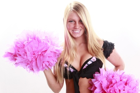 Young cheerleader and pink pom-pom photo