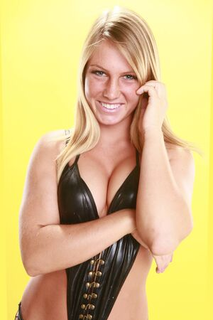 Black leather swimsuit on bright yellow backdrop Stock Photo - 14624173