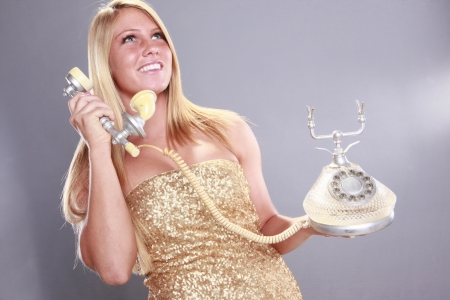 Vintage rotary phone and young blond photo