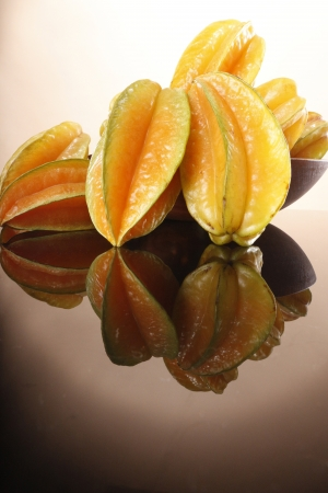 Fresh ripe star fruit in a wooden bowl Stock Photo - 16916068