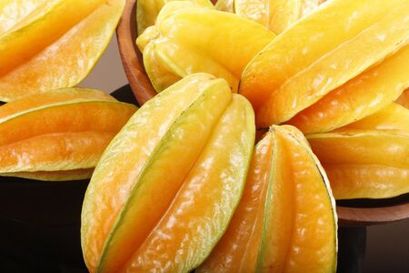 Fresh ripe star fruit in a wooden bowl Stock Photo - 16916057