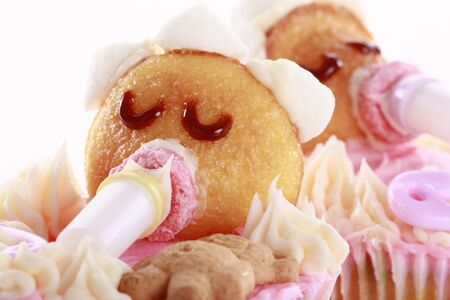 Baby shaped cupcakes - Shallow DOF - Focus on caramel eyelashes Stock Photo - 16916037