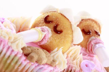 Baby shaped cupcakes - Shallow DOF - Focus on caramel eyelashes Stock Photo - 16916034