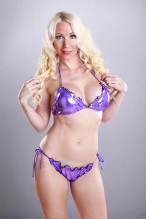 gorgeus: Face off with a gorgeus blond in purple bikini