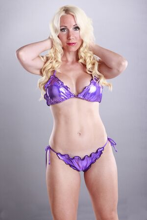 Face off with a gorgeus blond in purple bikini photo