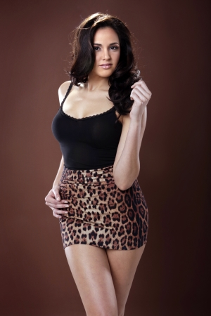 Good looking Latino young woman in animal print 版權商用圖片