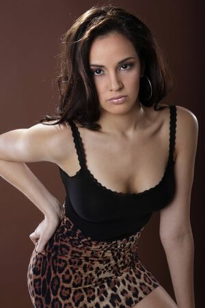 Good looking Latino young woman in animal print Stock Photo - 17124905