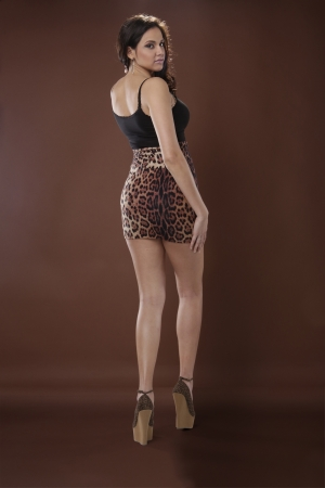 Good looking Latino young woman in animal print photo