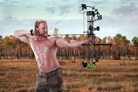 compound: man Hunting with a compound bow Stock Photo