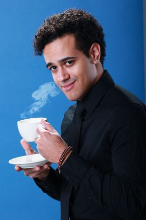 Young African American enjoys a cup of coffee Stock Photo - 18122691