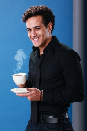 Young African American enjoys a cup of coffee Stock Photo - 18122687