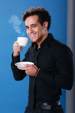 Young African American enjoys a cup of coffee Stock Photo - 18122686