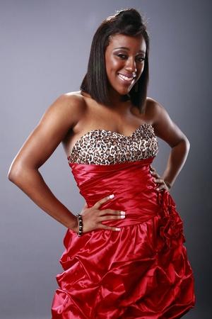 Cute brunette in red dress Stock Photo - 18122627