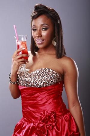 american sexy: Красные горячие девушки и холодное красный напиток Фото со стока
