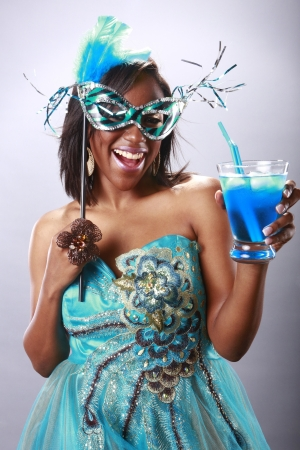 big smile: Cute party girl and blue cocktail