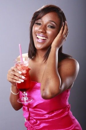 Magenta girl enjoys a red cocktail Stock Photo - 18122617