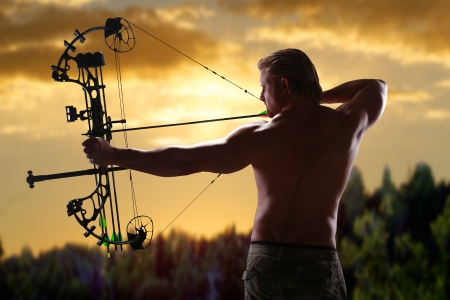 Hunting with a compound bow Archivio Fotografico