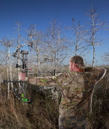 Hunting with a compound bow Stock Photo