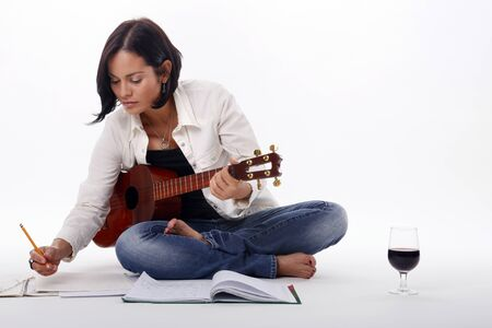 Composing while enjoying a glass of red wine Stock Photo - 18300128