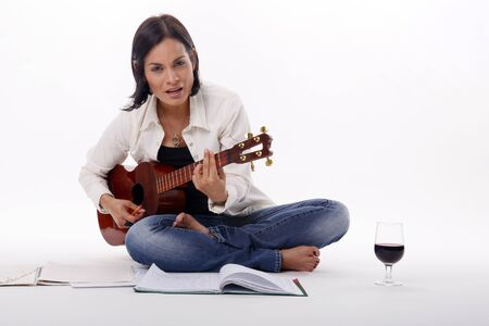 Composing while enjoying a glass of red wine Stock Photo - 18300119