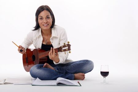 Composing while enjoying a glass of red wine Stock Photo - 18300125
