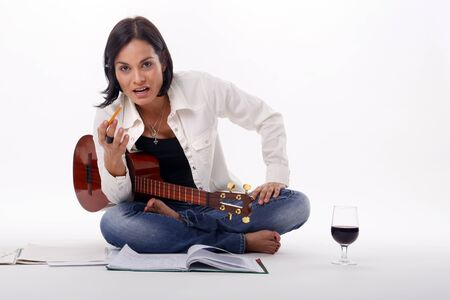 Composing while enjoying a glass of red wine Stock Photo - 18300121