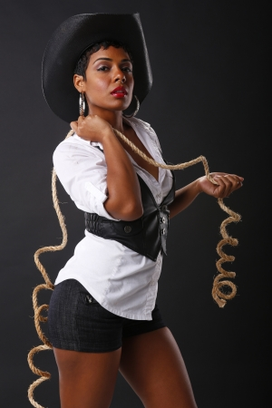 sexy girl dance: Help me make a lasso out of this rope Stock Photo