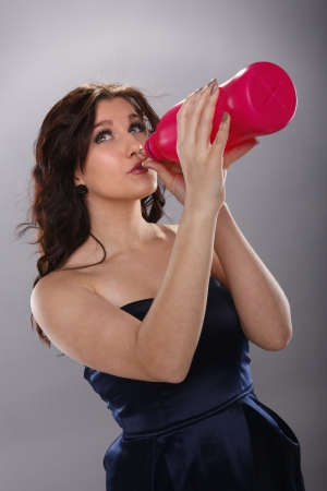 Young woman and large drink Stock Photo - 18970841