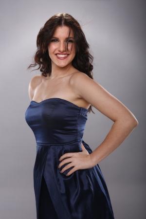 Gorgeous brunette in silk navy blue dress Stock Photo - 18970848