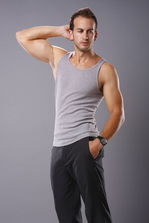tank top: Athletic young man in tank top