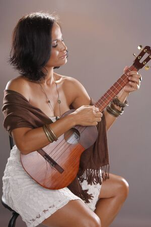 sexy guitar: Cute four string guitar performer Stock Photo