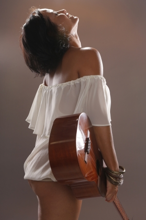 Cute four string guitar performer photo