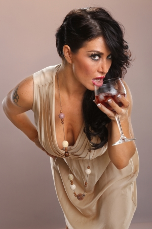 Hot brunette and red wine punch photo