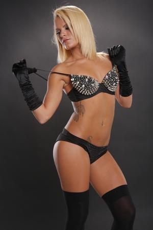 blonde bikini: Sexy blonde woman posing in black lingerie Stock Photo