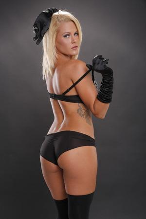 irish woman: Sexy blonde woman posing in black lingerie Stock Photo