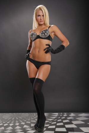 Sexy blonde woman posing in black lingerie photo