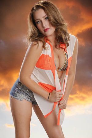 busty woman: Orange sunset girl