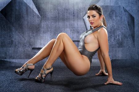 spandex: Voluptuous woman on a futuristic setting Stock Photo