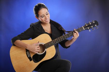 sexy guitar: Young guitarist Stock Photo