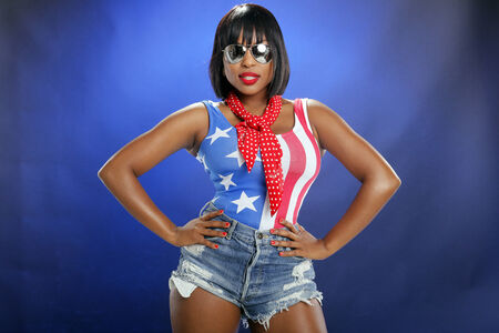 skintight: Caribbean girl in star-spangled attire Stock Photo
