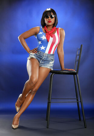 voluptuous women: Caribbean girl in star-spangled attire Stock Photo