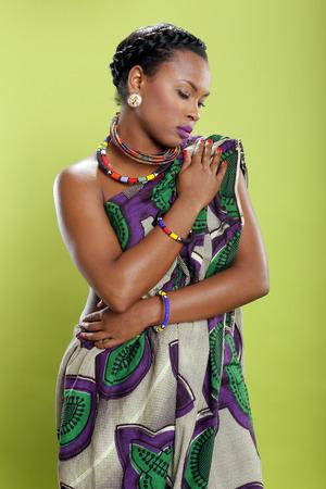tunic: Caribbean girl in pattern fabric tunic Stock Photo