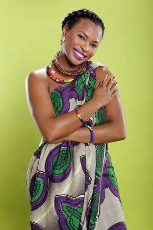 earthy: Caribbean girl in pattern fabric tunic Stock Photo