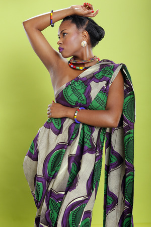 african women: Caribbean girl in pattern fabric tunic Stock Photo
