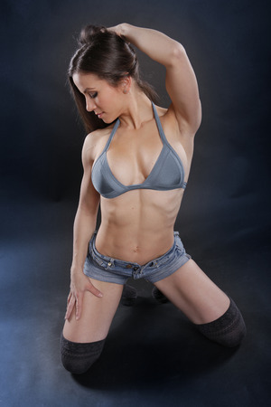 submissive: Cute and fit brunette on the floor Stock Photo