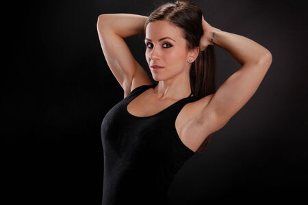 to tight: Fit girl stretches her arms